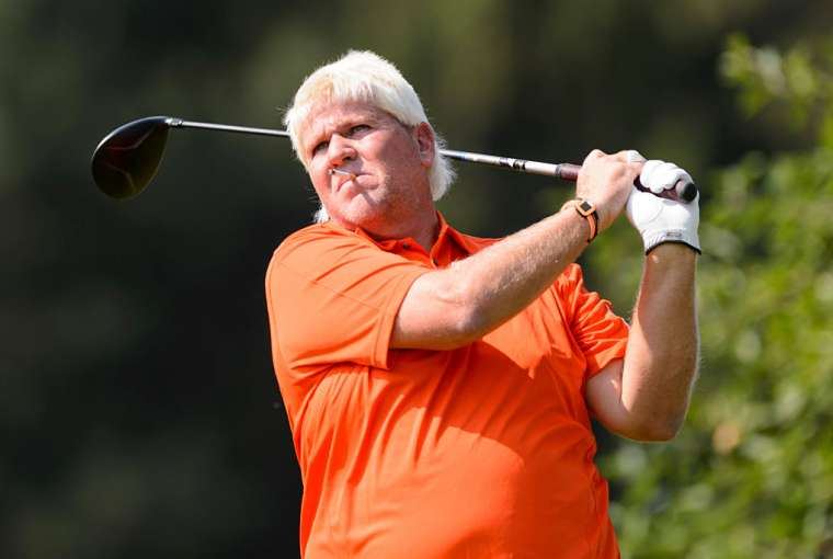 John Daly smoking a cigarette while playing golf