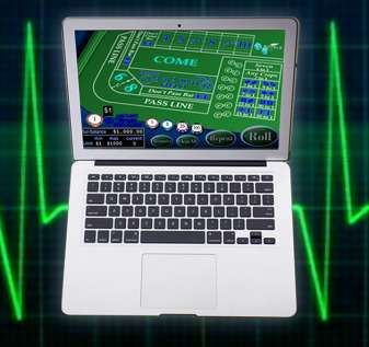 Laptop Dengan Latar Belakang Monitor Detak Jantung