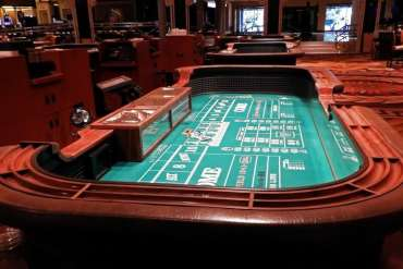 """The conviviality and excitement of a crowd craps table will be subdued when Caesars Palace Las Vegas reopens. State regulators will limit craps games to six players at each table. <span class=""""copyright"""">(Jay Jones)</span>"""