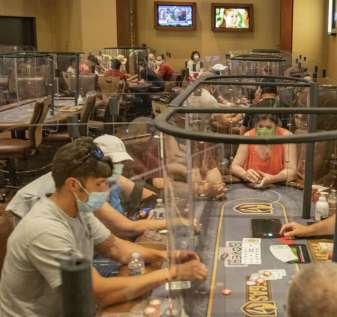 In this Aug. 3, 2020, file photo, Individuals play eight-handed poker games using plexiglass di ...