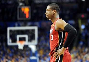 Dwyane Wade looking unhappy during an NBA game